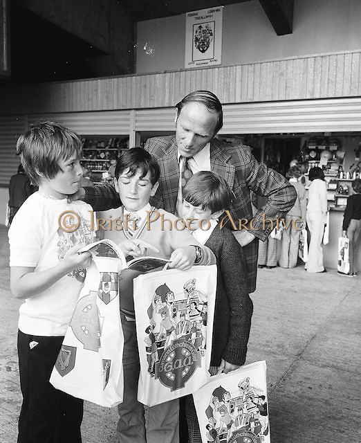 Three boys show a leader a brouchure on their visit to Croke Park during a Kells Educational Tour on the 12th of June 1975.