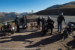 Motorcycle Cannonballers stop for a photo while crossing the Continental Divide at the top of Loveland Pass during Stage 10 (278 miles) of the Motorcycle Cannonball Cross-Country Endurance Run, which on this day ran from Golden to Grand Junction, CO., USA. Monday, September 15, 2014.  Photography ©2014 Michael Lichter.
