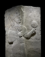 Hittite relief sculpted orthostat stone panel of Long Wall Basalt, Karkamıs, (Kargamıs), Carchemish (Karkemish), 900 - 700 B.C. Anatolian Civilizations Museum, Ankara, Turkey.<br /> <br /> Goddess Kubaba. Goddess is depicted from the profile. The part below the chest of the relief is broken. She holds a pomegranate in her hands on her chest. She carries a one-horned headdress on her head. Her braided hair hangs down to her shoulder. The text in the hieroglyphics is not understood. The lower part of the relief has been restored. <br /> <br /> On a black background. .<br />  <br /> If you prefer to buy from our ALAMY STOCK LIBRARY page at https://www.alamy.com/portfolio/paul-williams-funkystock/hittite-art-antiquities.html  - Type  Karkamıs in LOWER SEARCH WITHIN GALLERY box. Refine search by adding background colour, place, museum etc.<br /> <br /> Visit our HITTITE PHOTO COLLECTIONS for more photos to download or buy as wall art prints https://funkystock.photoshelter.com/gallery-collection/The-Hittites-Art-Artefacts-Antiquities-Historic-Sites-Pictures-Images-of/C0000NUBSMhSc3Oo