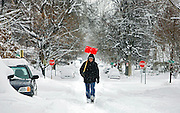 Nathaniel Martinez (cq), 15, walks down Clay Street near West 40th Ave. in Northwest Denver on his way to Decatur West Nursing Home where he works to help out shoveling sidewalks on Thursday. Heavy snowfall and blowing winds have caused widespread closures and cancellations around Denver as a slow moving snow storm made its way through the area Thursday December 21, 2006. The snow started falling early Wednesday and finally started to taper off mid-day Thursday with as much as two feet of snow on the ground around the Denver area. Local residents spent much of the morning on Thursday trying to dig out of one of the largest winter storms in years. .(MARC PISCOTTY/ROCKY MOUNTAIN NEWS) CQ Nathaniel Martinez