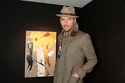 Singer-songwriter MATT GOSS at a private view of an exhibition of paintings by Billy Zane entitled 'Save The Day Bed' held at the Rook & Raven Gallery, Rathbone Place, London on 10th October 2013.