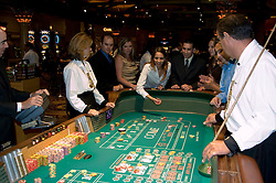 Craps table in Las Vegas, Nevada, Caesars Palace and Casino, gaming, gambling, craps, craps players, throwing dice, die, model released, craps table, NV, Las Vegas, Photo nv224-17956..Copyright: Lee Foster, www.fostertravel.com, 510-549-2202,lee@fostertravel.com