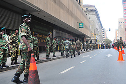 JOHANNESBURG, SOUTH AFRICA – APRIL 07: MKMVA members gather outside Luthuli House in support of the ANC and Zuma amidst calls for President Zuma to step down, in Johannesburg, South Africa, 07 April 2017. Businesses closed and South Africans from numerous political, religious, labour and civic groups gathered at central points across the entire country protesting against President Zuma's recent government reshuffle appointing 10 new ministers and 10 new deputy ministers including the axing of the finance minister. Photo: Dino Lloyd