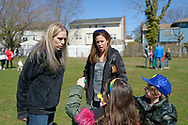 North Merrick, New York, USA. March 31, 2018. L-R, SUE MOLLER, the Co-President of North and Central Merrick Civic Association; and ALISON FRANKEL, the President of South Bellmore Civic Association, look at Easter eggs a girl and boy found during Egg Hunt  at the 16th Annual Eggstravaganza, held at Fraser Park. Event was co-hosted by NCMCA and American Legion Auxiliary Unit 1282.