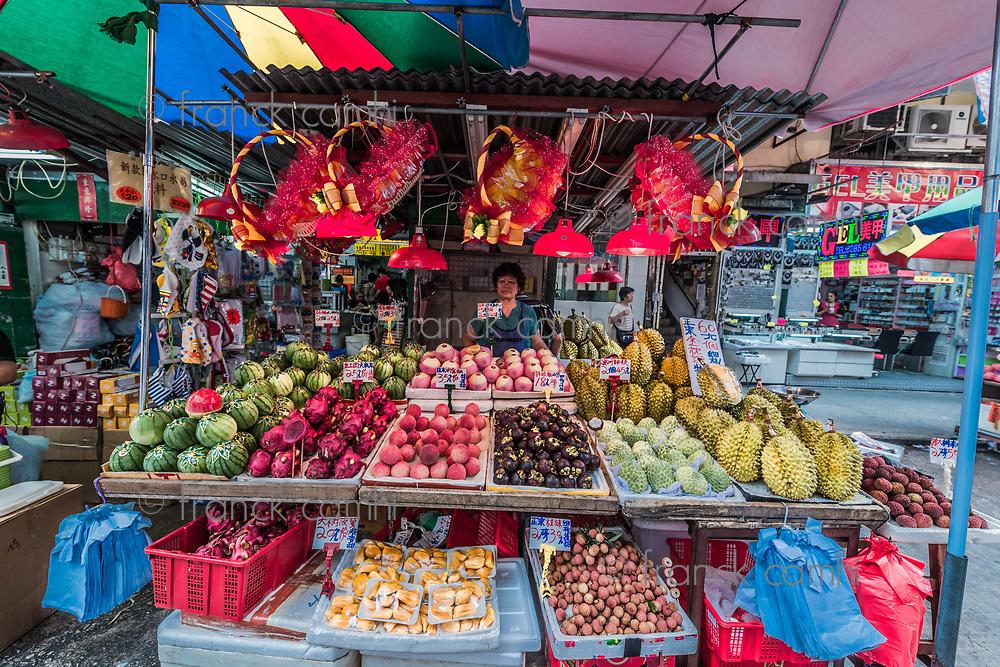 Kowloon, Hong Kong, China- June 9, 2014: people at Mong Kok fruit market