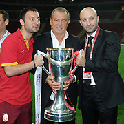 Galatasaray coach Fatih Terim (C) celebrate with the trophy after their Turkish Super League soccer match against Trabzonspor at Turk Telekom Arena stadium May 18, 2013.Galatasaray won the Turkish league title for the 19th time. Photo by TURKPIX