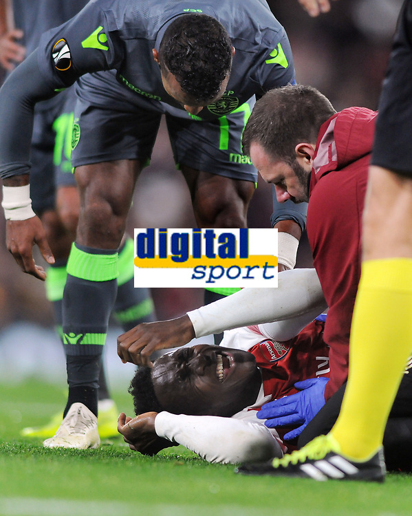 Football - 2018 / 2019 UEFA Europa League - Group E: Arsenal vs. Sporting Lisbon<br /> <br /> Danny Welbeck does down in pain with a bad ankle injury which ended his match, at The Emirates.<br /> <br /> COLORSPORT/ANDREW COWIE