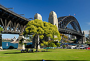 Sydney Harbour Bridge's northern approach, with the Sydney Opera House in the background. Sydney, Australia