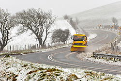© Licensed to London News Pictures. 30/01/2021. Llanfihangel Nant Melan, Powys, Wales, UK.A gritter truck works through blizzard conditions on the A44 road near Llanfihangel nant Melan in Powys, Wales, UK. Photo credit: Graham M. Lawrence/LNP