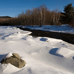 The Androscoggin River in early spring in Twin Mountain, New Hampshire.  Snow and ice.
