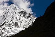 The peak of Navado Alpamayo in Peru, famous for its nearly perfect triangular peak