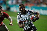 HONG KONG, HONG KONG : Osea Kolinisau of Fiji scores against Wales in Fiji's 26-19 win in the Cup Final, to defend their Hong Kong Rugby Sevens title, shown in Hong Kong on Sunday, 24 March, 2013.