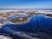 Nederland, Noord-Holland, Ronde Venen, 13-02-2021; schaatsers op de Groote Wije, onderdeel van het Natuurreservaat Botshol (tussen Vinkenveen en Ouderkerk). In de achtergrond Amsterdam Buitenveldert en Zuisoost.<br /> Ice skaters on frozen lake - natural reserve - during skating tour,<br /> <br /> luchtfoto (toeslag op standaard tarieven);<br /> aerial photo (additional fee required)<br /> copyright © 2021 foto/photo Siebe Swart