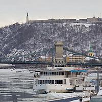Ship named Europe is seen docked on river Danube among ice blocks in Budapest, Hungary on February 15, 2012. ATTILA VOLGYI