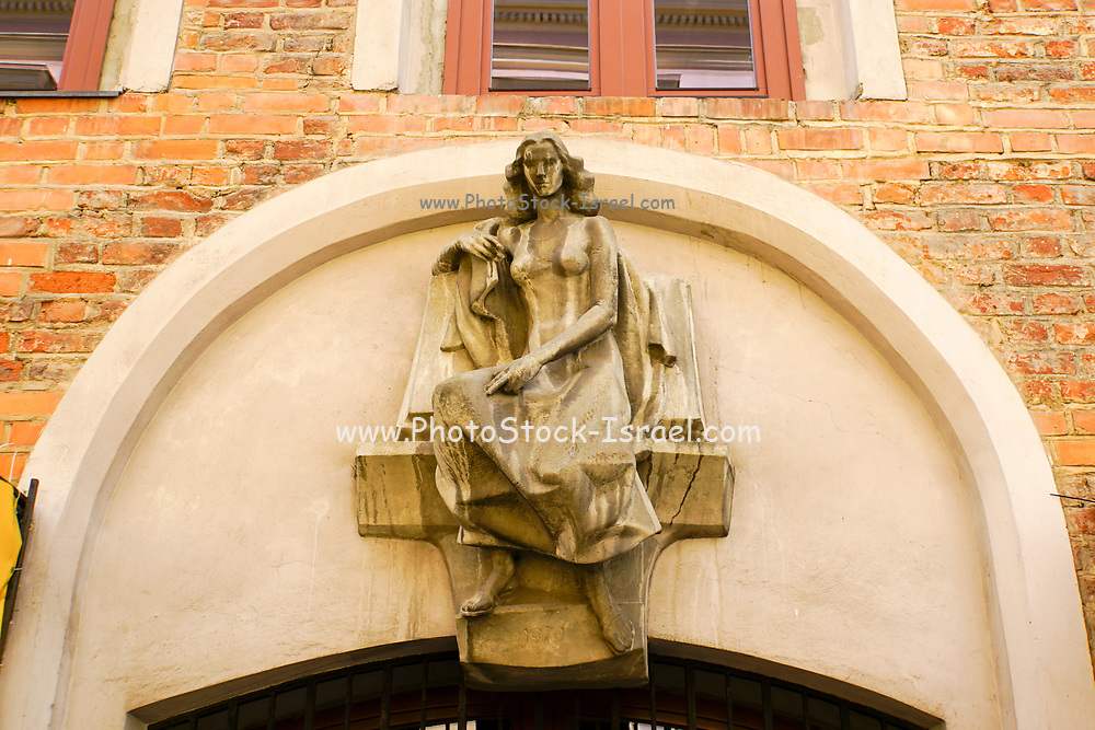 Statue of a woman on the facade of a building in Pilies street, in old town Vilnius Lithuania