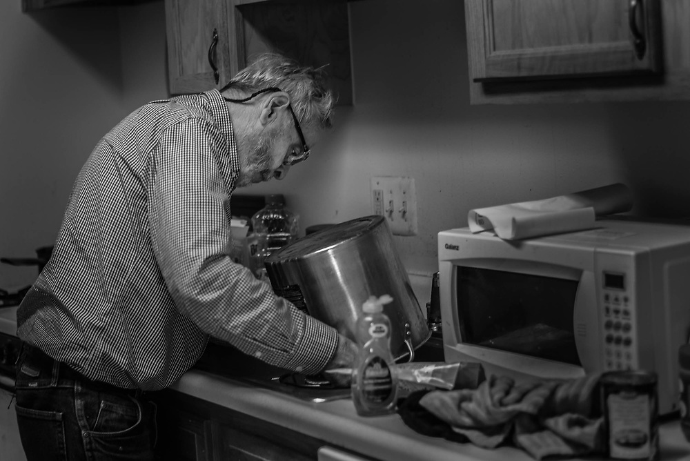 Fairfax, Virginia. April 2nd 2019 - Gene Broyhill, 78, washing the utensil for preparing his dinner after he returned from the Lamb Center.