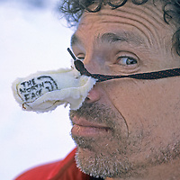 BAFFIN ISLAND, Canada. Greg Child clowns about expedition sponsorship at base camp, Great Sail Peak.