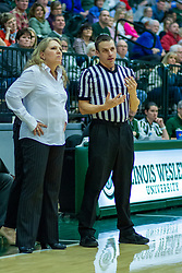BLOOMINGTON, IL - January 04: Mia Smith chats with Jason Schmitz during a college women's basketball game between the IWU Titans  and the Millikin Big Blue on January 04 2020 at Shirk Center in Bloomington, IL. (Photo by Alan Look)