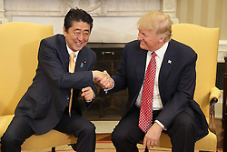 February 10, 2017 - Washington DC, USA - Japanese Prime Minister SHINZO ABE shakes hands with U.S. President DONALD TRUMP (R) during their meeting in the Oval Office at the White House(Credit Image: © Chip Somodevilla/Pool/CNP via ZUMA Wire)
