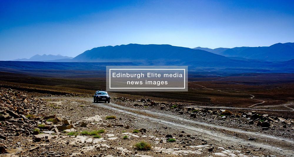 A car nakes it's way along the piste from Tamtetoucht to Msemrir, Morocco<br /> <br /> (c) Andrew Wilson   Edinburgh Elite media