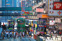 Pedestrians crossing street in the Central District, Hong Kong, China
