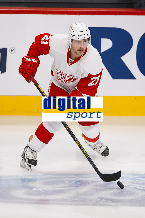 05 April 2014: Tomas Tatar 21 of the Detroit Red Wings skates with the puck during the warmup period prior to the NHL Eishockey Herren USA match against the Montreal Canadiens at the Bell Centre in Montreal Quebec, Canada. The Canadiens defeat the Red Wings 5-3. NHL Eishockey Herren USA APR 05 Red Wings at Canadiens<br />  Norway only