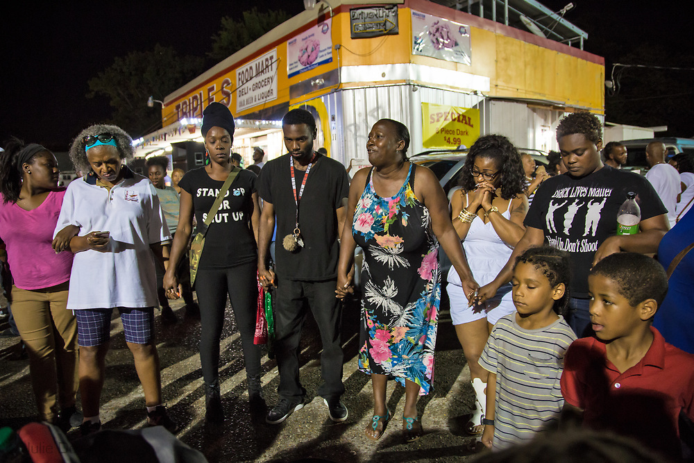 Veda Washington-Abusaleh, ( in floral dress) aunt of Alton Sterling, at a vigil for Sterling on May 2, 2017 in Baton Rouge, Louisiana held in front of  the Trilple S Food Mart U.S. the day news got out that the Justice Department  will not prosecute thee police officer who shot and killed Sterling last summer.