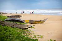 Dugout canoes on the beach with children playing in background, Magical Madagascar. People and places fine art photography prints
