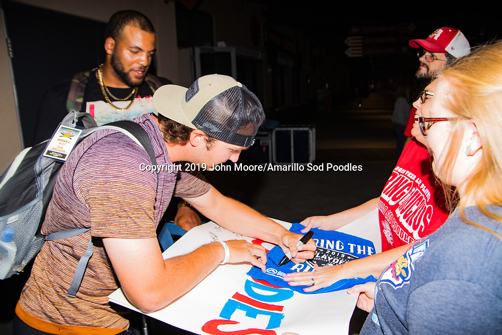 Amarillo Sod Poodles pitcher Sam Williams (20) signs autographs during the homecoming celebration after the Sod Poodles won the Texas League Championship early on Monday, Sept. 16, 2019, at HODGETOWN in Amarillo, Texas. [Photo by John Moore/Amarillo Sod Poodles]