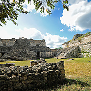 Ground level view of ruins at the ancient Mayan ruins at Ek'Balam, near Valladolid, Yucatan, Mexico. At left is the Oval Palace and at right is one of the two Twin Pyramids.
