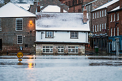© Licensed to London News Pictures. 08/02/2021. York UK. The Kings Arms pub in York city centre is covered in snow & surrounded by flood water this morning as Storm Darcy continues to batter the uk. Photo credit: Andrew McCaren/LNP