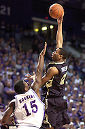 Colorado forward Martane Freeman (R) shoots over Kansas State's David Hoskins (L) during the first half of the Wildcats 72-60 win over the Buffaloes at Bramalage Coliseum in Manhattan, Kansas, February 18, 2006.