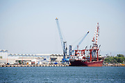 Israel, Haifa, Port of Haifa, the largest port in Israel. Harbour Crane unloads a cargo ship