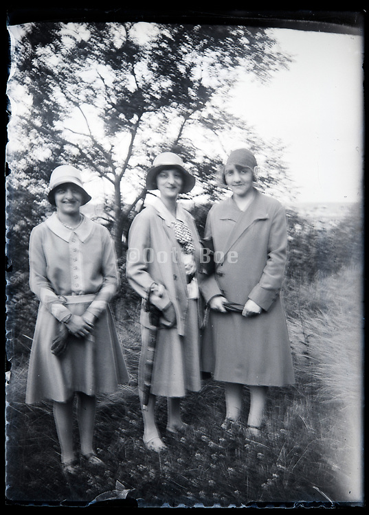 three happy adult women putting up a pose France circa 1920s