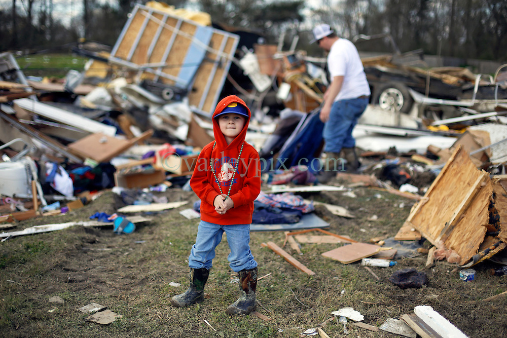24 February 2016. Sugar Hill RV Park, Convent, Louisiana.<br /> Scenes of devastation following a deadly EF2 tornado touchdown. 2 confirmed dead. <br /> Zachary Brown and his 4 yr old son Garrett recover all they can from their destroyed trailer.<br /> Photo©; Charlie Varley/varleypix.com