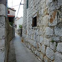 Back alley stone wall streets;<br />Split, Croatia. 2018