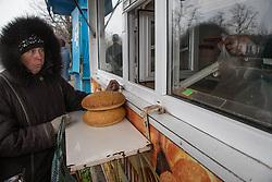 A woman buys bread in a neighbourhood of Debaltsevo.