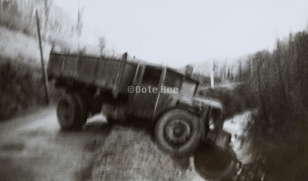 vintage image of a truck that slipped of the road