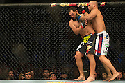 Johny Hendricks takes a shot to the chin from Robbie Lawler during UFC 171 at the American Airlines Center in Dallas, Texas on March 15, 2014.