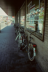 Bicyclist Lined Up At Store