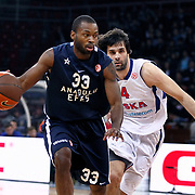Anadolu Efes's Oliver Lafayette (L) and CSKA Moscow's Milos Teodosic (R) during their Euroleague Top 16 basketball match Anadolu Efes between CSKA Moscow at the Abdi Ipekci Arena in Istanbul at Turkey on Thursday, March, 01, 2012. Photo by TURKPIX