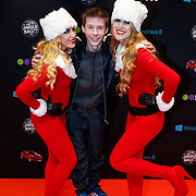 NLD/Amsterdam/20121222 - Inloop 538Jingleballs 2012, dj Erik Arbores met 2 kerstengelen