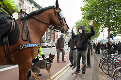 "© Licensed to London News Pictures.04/06/2016. Bristol, UK. Police and anti-fascists at protests in Bristol city  centre between the anti-immigration ""South West Infidels"" and anti-fascist campaigners and Bristol Welcomes Refugees. There was  heavy police presence with dogs and horses, but only 18 anti-immigration protesters were escorted by police onto Bristol's College Green which was blocked off to the public by a ring of steel barriers. Photo credit: Simon Chapman/LNP"