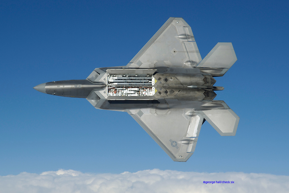 F/A-22 open bay showing AMRAAM missiles