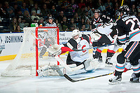KELOWNA, CANADA - OCTOBER 23: Mack Shields #1 of Prince George Cougars misses a save from a shot by Justin Kirkland #23 of Kelowna Rockets on October 23, 2015 at Prospera Place in Kelowna, British Columbia, Canada.  (Photo by Marissa Baecker/Shoot the Breeze)  *** Local Caption ***Justin Kirkland; Mack Shields;