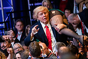 A protestor dressed as U.S. President Donald Trump throws a woman over his should as he interrupts U.S. Vice President Mike Pence's speech at the Conservative Political Action Conference, CPAC 2020, in Oxon Hill, Md., on Thursday, February 27, 2020.