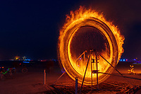 Fire Spinner by: Anton Viditz-Ward from: Telluride, CO year: 2017<br /> <br /> Fire Spinner is a steel mechanical wheel 13′ tall, it has 2 steel baskets that hold wood. Those baskets are set on fire, the wheel is then set in motion via a 20′ long drive shaft and a hand crank mechanism. Fire Spinner is inspired from watching people spinning Poi, it is an interpretation of that art form. Black Rock City Participants will have the opportunity to spin the wheel via the crank mechanism. Contact: antonviditzward@gmail.com