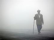 Man walking in the mist near Kigali, Rwanda