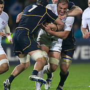 Mamuka Gorgodze, Georgia, is tackled by Ross Rennie, Scotland, (left) during the Scotland V Georgia Pool B match  during the IRB Rugby World Cup tournament.  Invercargill, New Zealand, 14th September 2011. Photo Tim Clayton...