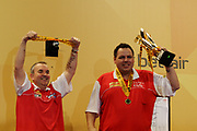 """Darts: Betfair Team World Cup 2013, Hamburg, 03.02.2013<br /> Phil """"The Power"""" Taylor (l.) and Adrian Lewis (ENG) celebrates with the Trophy<br /> © Torsten Helmke"""